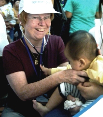 Chris Whitten examines an impatient patient during a volunteer surgical team trip to Vietnam